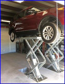 In ground flush mount, scissor hydraulic vehicle lift